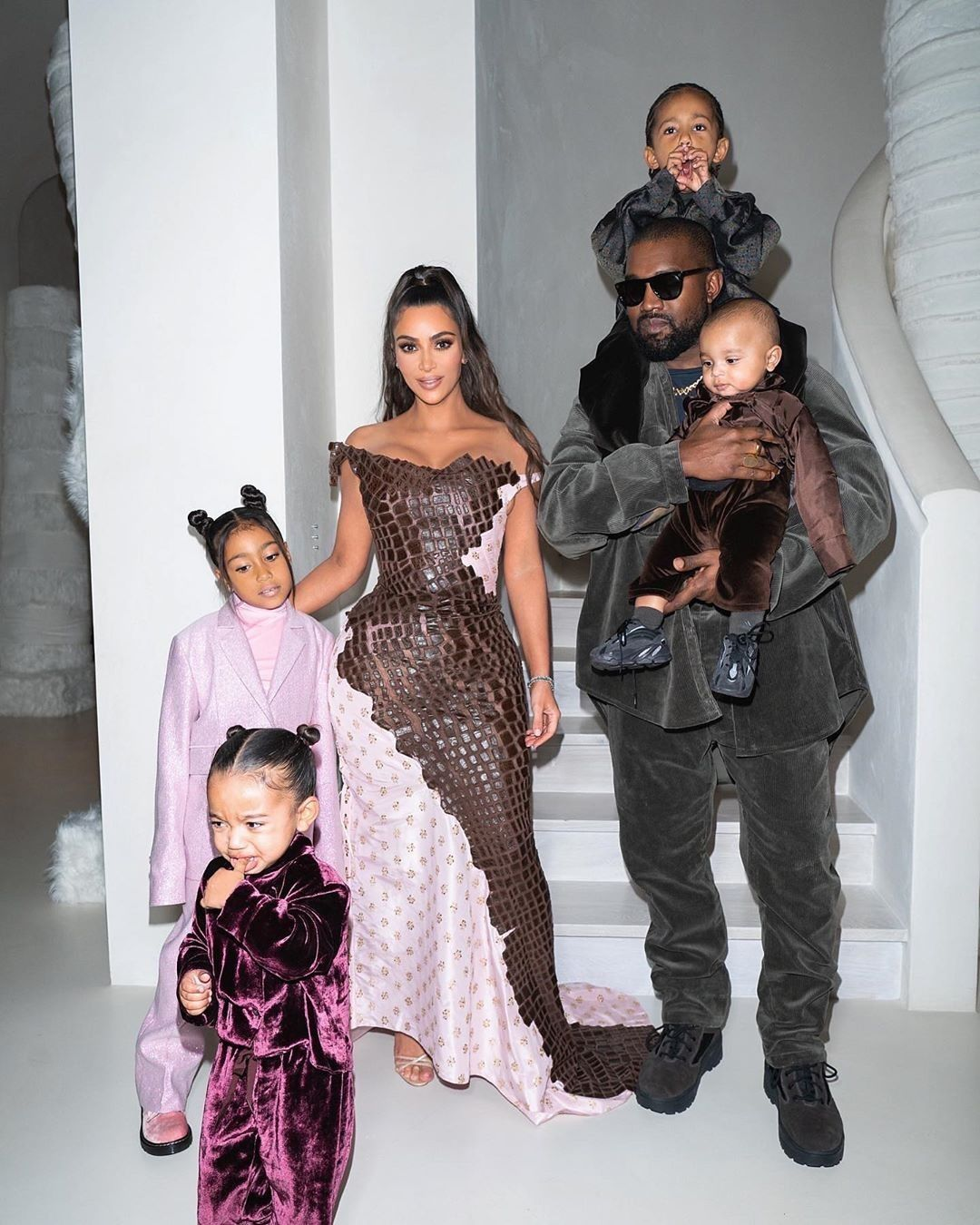 Kanye West and Kim Kardashian with their children: North, Saint, Psalm and Chicago