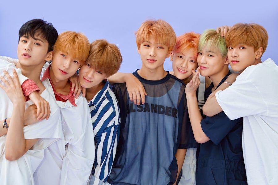 7 NCT DREAM Members posing for album photoshoot