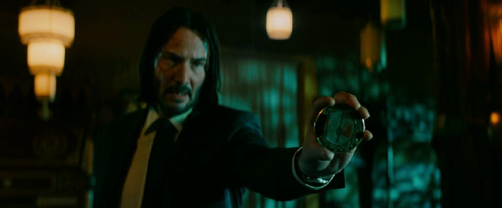 What Is Inside The Pendant Of John Wick 3?