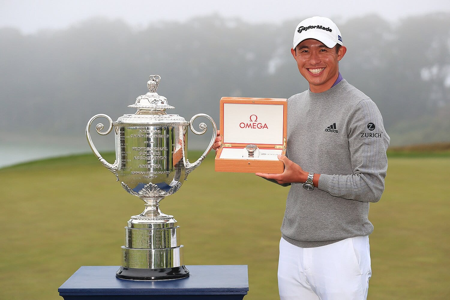 Collin Morikawa of the United States celebrates with the Wanamaker Trophy and the champion's watch after winning the 2020 PGA Championship at TPC Harding Park