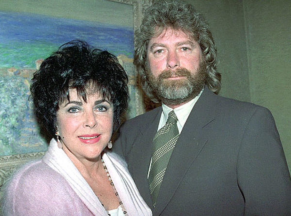 Elizabeth Taylor and her then-husband Larry Fortensky visit New York in June 1995.
