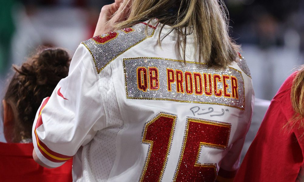 Randi Martin donning her custom made Chiefs jersey signed by her son Patrick Mahomes.