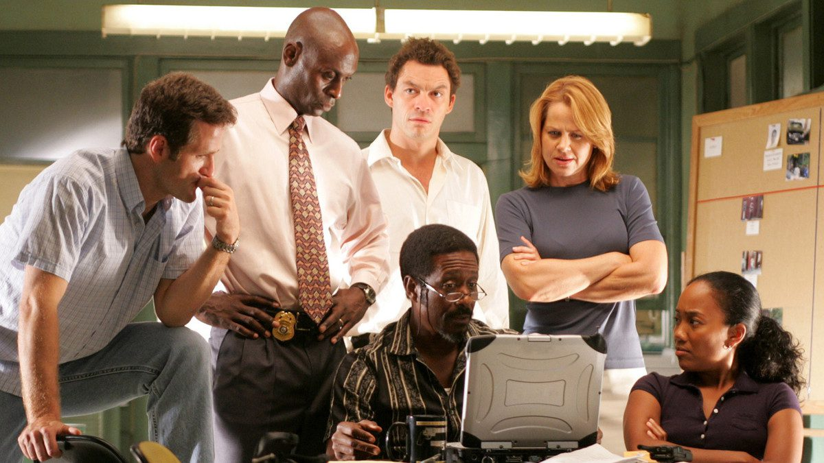 The Wire cast stands together in a scene